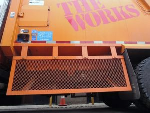 A view of the left side guard on a truck operated by the City of Cambridge, Massachusetts