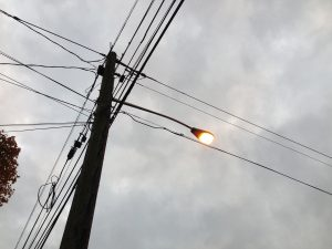 A high pressure sodium streetlight at dusk